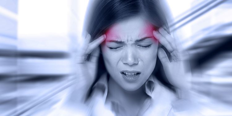 Photo of woman suffering from tension type headache