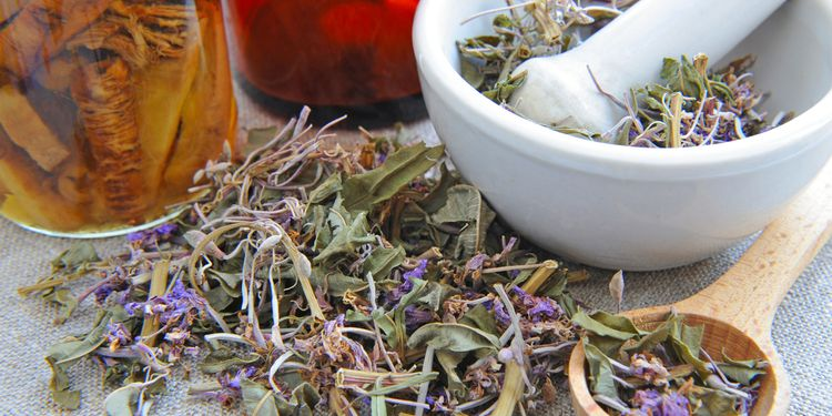 Photo of dry herbal tea Chamerion is with tinctures in bottles on sackcloth, herbal medicine