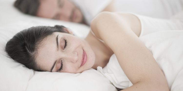 Photo of happy woman sleeping