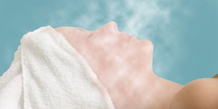 Photo of woman having steam therapy for acne