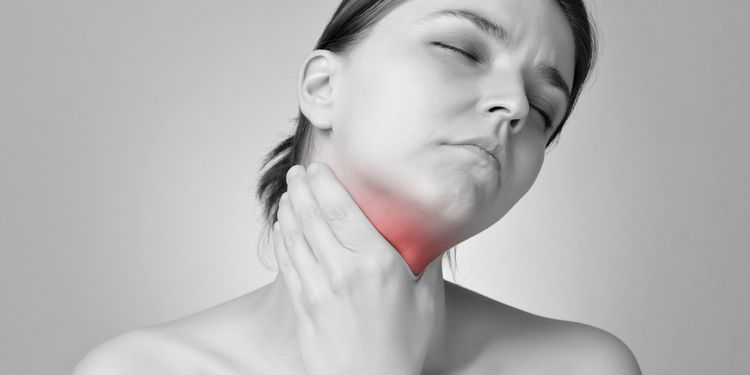 Photo of a woman with thyroid pain