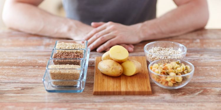 Photo of different staple foods in front of a person