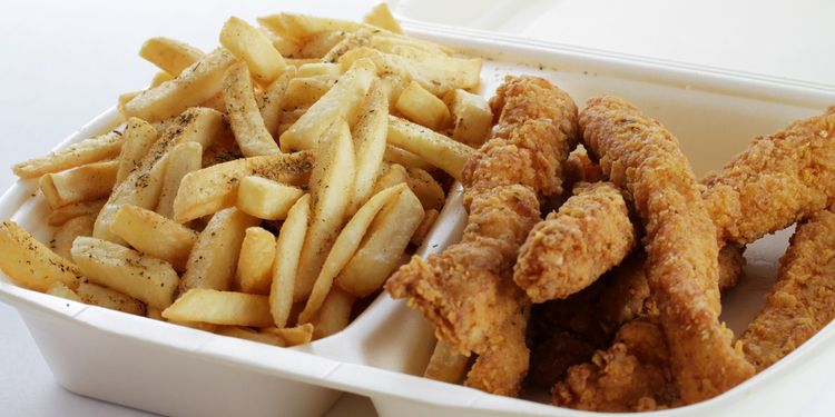 Photo of chicken wings with fries