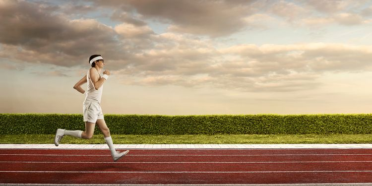 Photo of a man jogging on a track