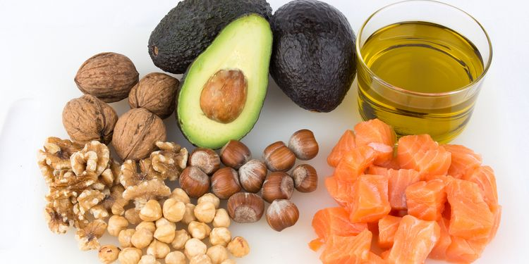 Photo of different nuts and fish rich in healthy oils
