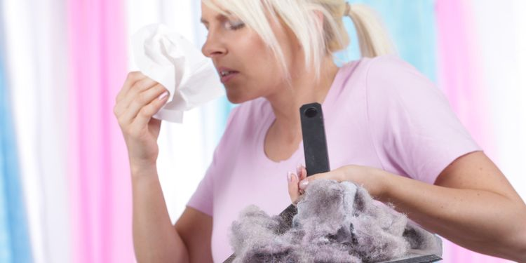 Photo of a woman having dust alergy