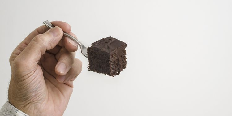 Photo of a chocolate cake on a fork