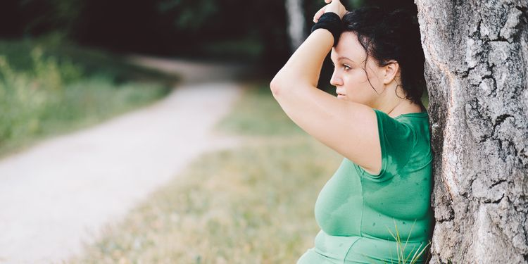 Photo of an overweight girl exhausted after running