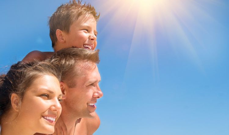 Photo of family outdoors in sunlight