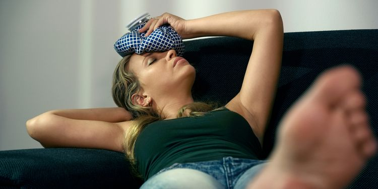 Photo of an ill woman on couch