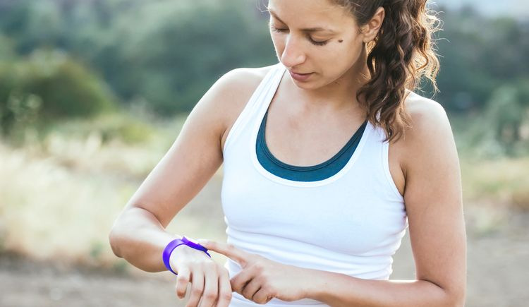Photo of woman looking at fitness tracker