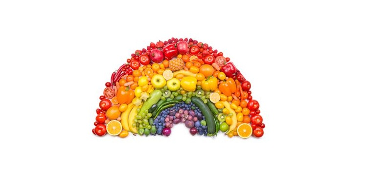 Photo of a fruit arranged in a form of rainbow