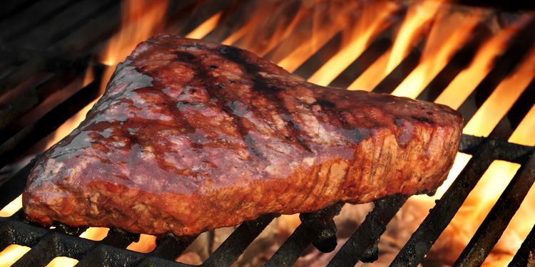 Photo of beef steak on a grill