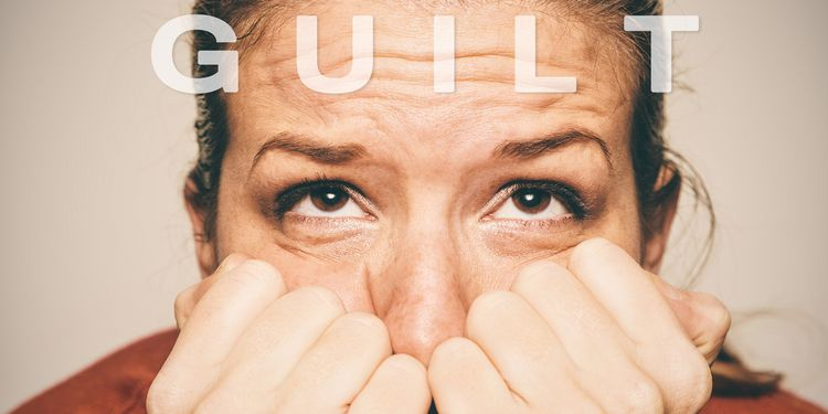 Photo of woman showing signs of guilt