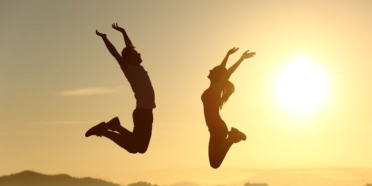 Photo of people jumping in sunset