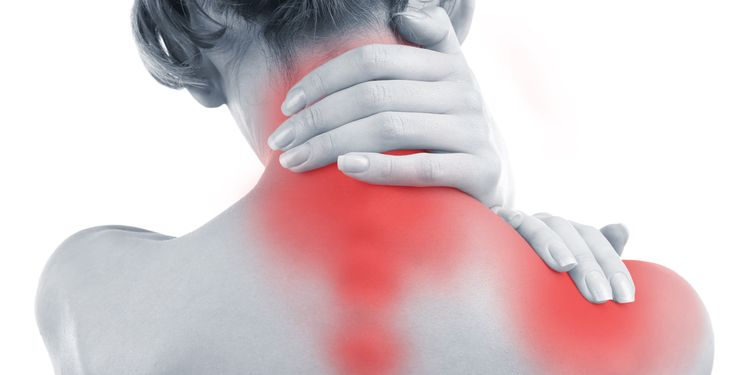 Photo of a woman holding her inflamed neck muscles