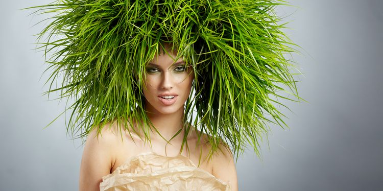 Photo of a woman with grass growing on her head