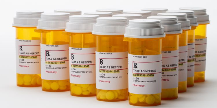 Photo of bottles with medication pills