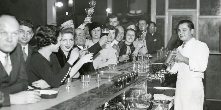 Photo of people drinking at a bar, Prohibition Ending in 1933