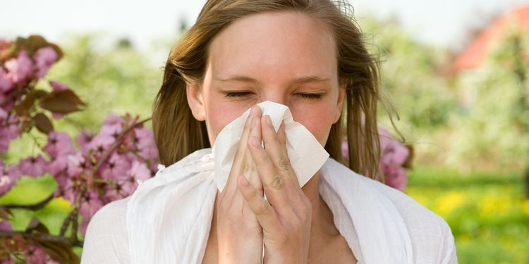 Photo of a girl with runny nose caused by sinusitis