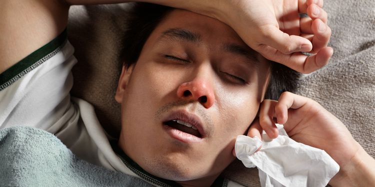 Photo of a man with runny nose