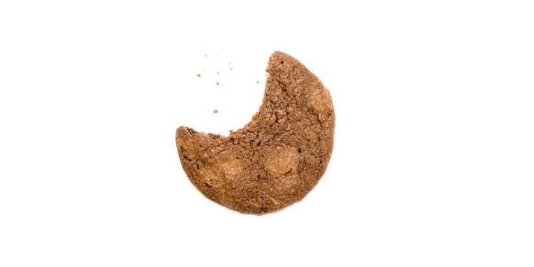 Photo of a cookie with one bite less