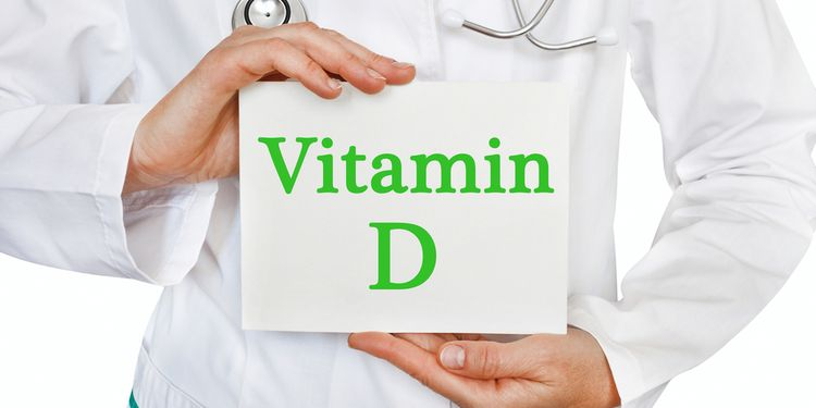 Photo of a doctor holding paper with VITAMIN D written on