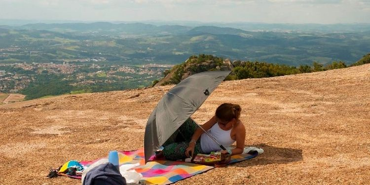 Image of the person reading a book outdoors