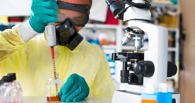 Photo of a lab technician doing tests with a pipette