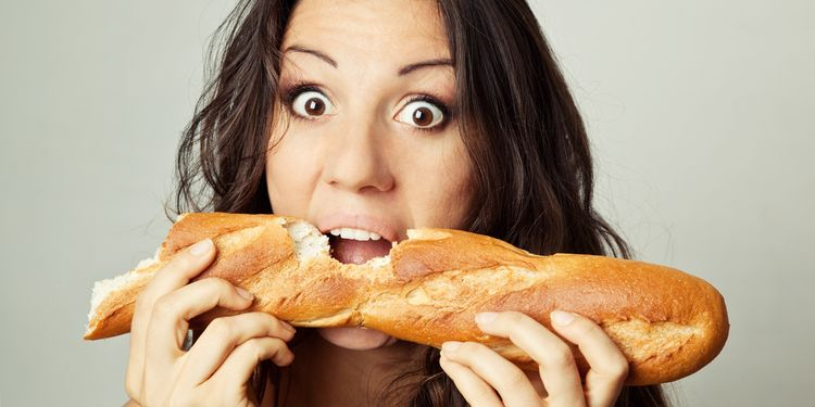 Photo of a woman eating french bread