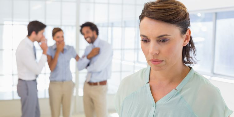 Photo of coworkers talking behind colleague's back