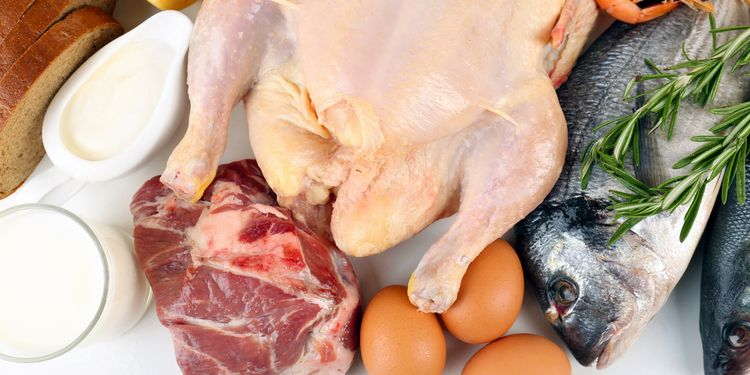 Photo of raw chicken, fish and beef meat
