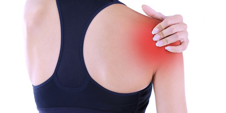 Photo of a woman holding her shoulder in pain