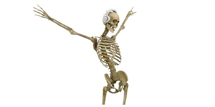 Photo of a skeleton dancing with headset