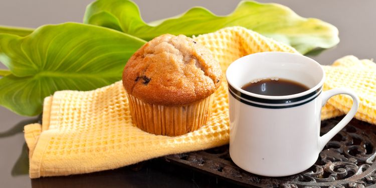 Photo of a muffin and coffee in a cup