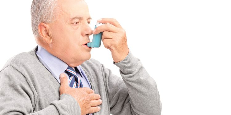 Photo of a man taking asthma medication