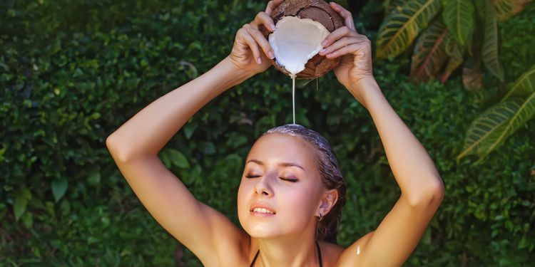 Photo of a girl using coconut milk on hair