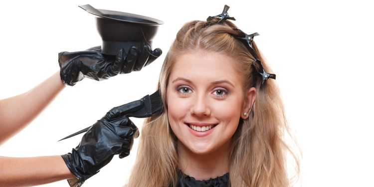 Photo of a woman using hear dye on her hair