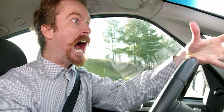 Photo of a man in traffic jam Screaming in anger