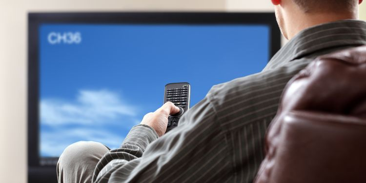 Photo of a sedentary man watching TV