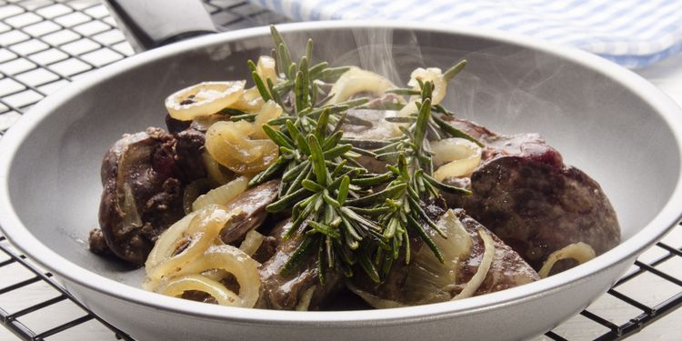Photo of cooked liver with onions in a plate