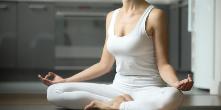 Photo of a young woman meditating
